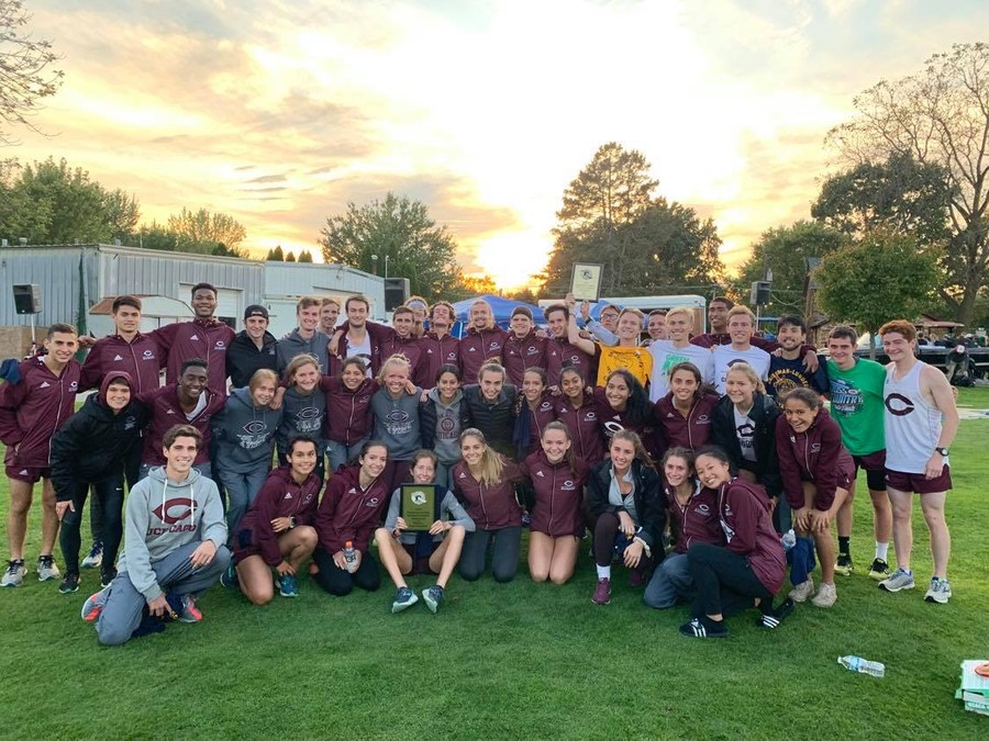 The cross country poses for a photo after a meet in autumn of 2019.