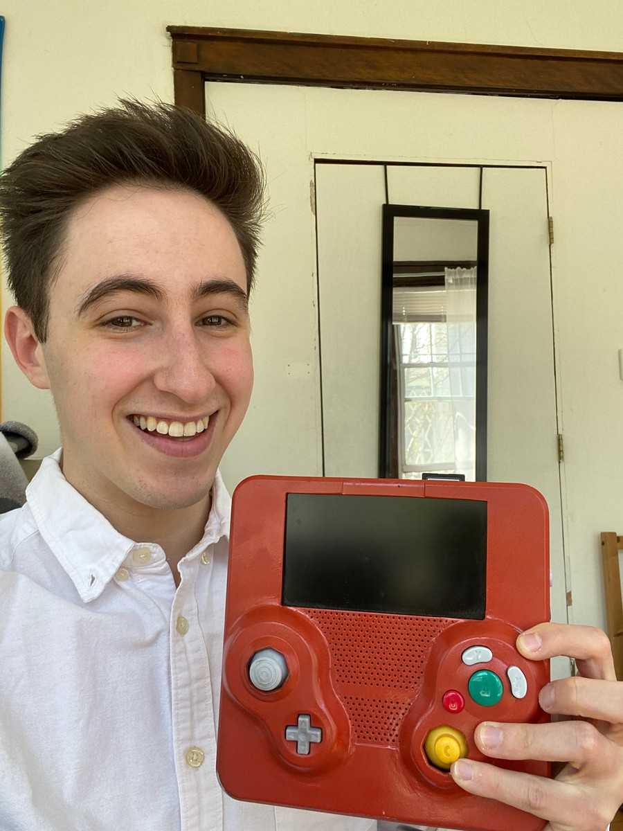 Elliot Kahn holds aloft his homemade GameCube - now abandoned in favor of a (store-bought) Nintendo Switch.