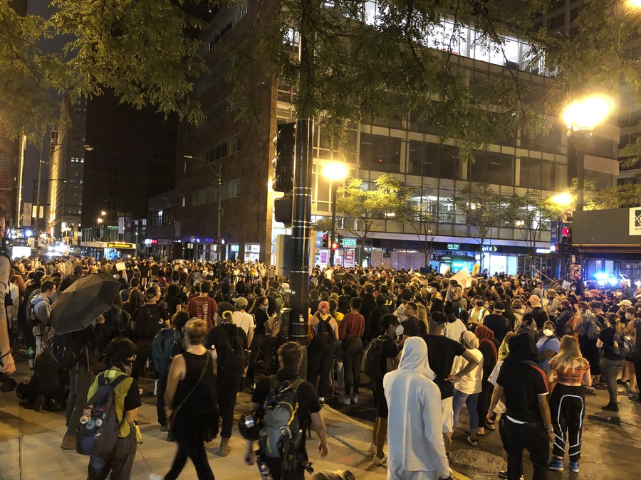 College students from across Chicago occupy a Loop intersection as they demonstrate support for police abolition.