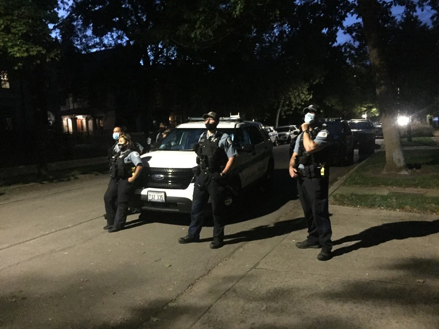 Chicago Police look on at a protest by #CareNotCops in front of Provost Ka-Yee Lee's house, September 2020.