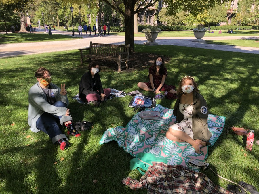 Pictured (Left to Right): Players Tristan Bachmann, Arielle Roane, Melia Allan, and Liz Chen have a socially-distanced picnic.