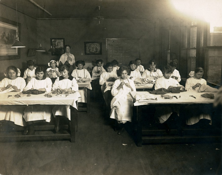 Students In Sewing class at the University of Chicago settlement school, May 17, 1918, several months before the flu arrived.