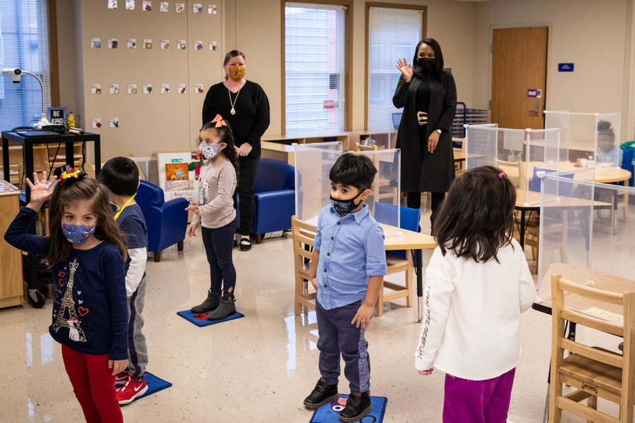 Chicago Public Schools CEO Janice Jackson waves to students in a preschool classroom at Dawes Elementary School on Jan. 11, 2021.
