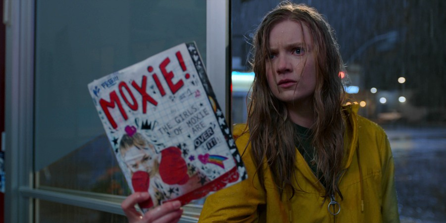 "Vivian (Hadley Robinson), the heroine of ""Moxie"", holds up the titular magazine defiantly. Because she is defiant. And defies the patriarchy."