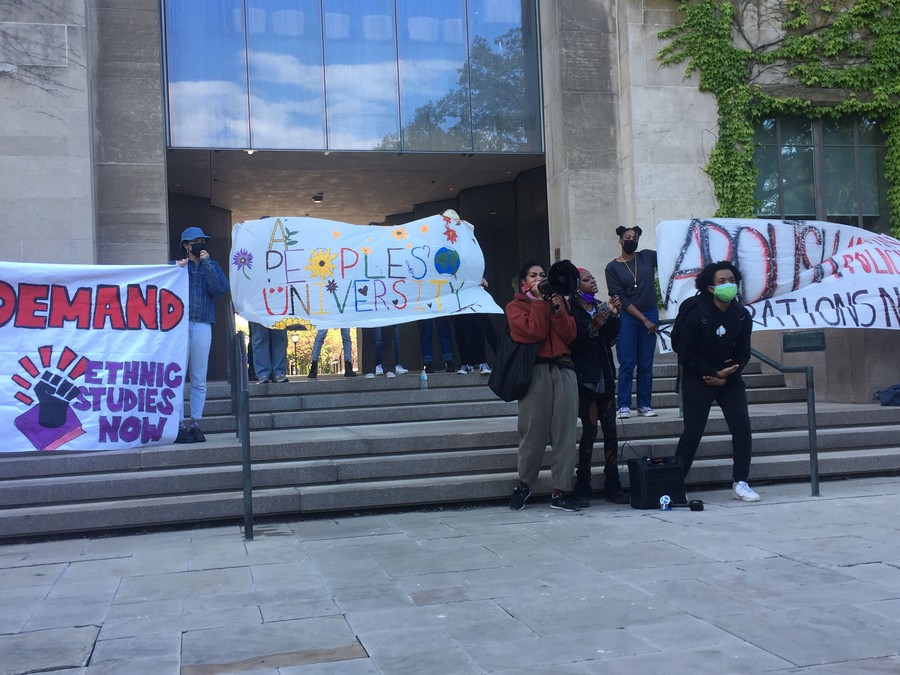 Rally organizers stood with banners outside Levi Hall.