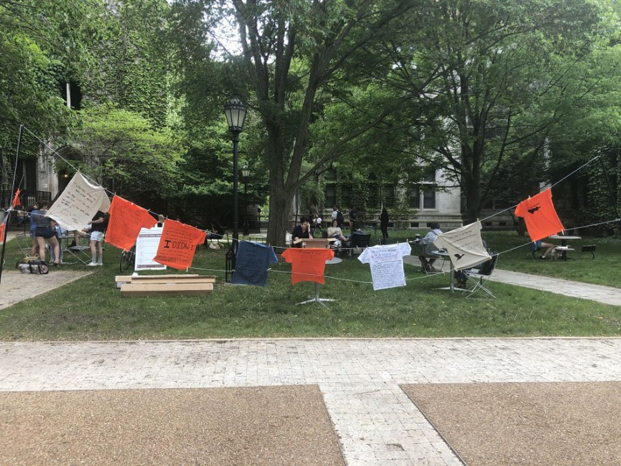 16 T-shirts in various colors hung in the courtyard outside Hutchinson Commons as part of The Clothesline Project.