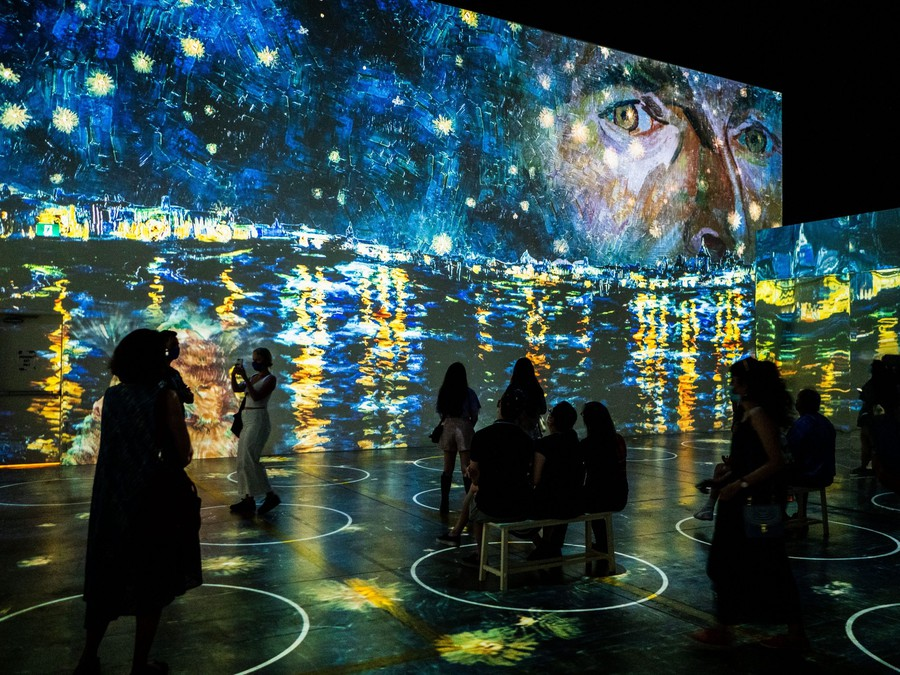 Audiences experience Vincent van Gogh's work from within the art in the Immersive van Gogh Exhibit.
