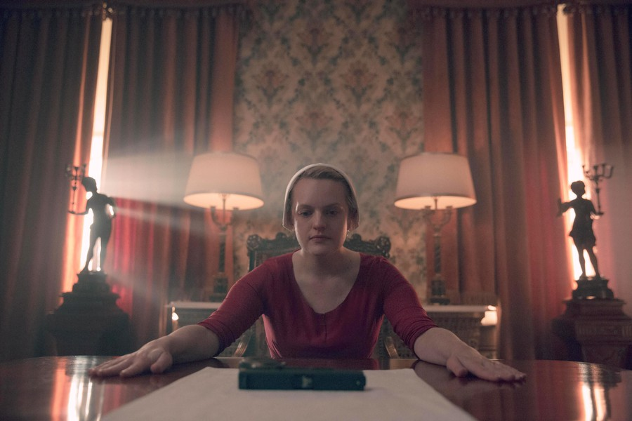 """""""The Handmaid's Tale"""" remains mired in the endless drama, slow-motion close-ups, red capes, and suffering of Gilead."""